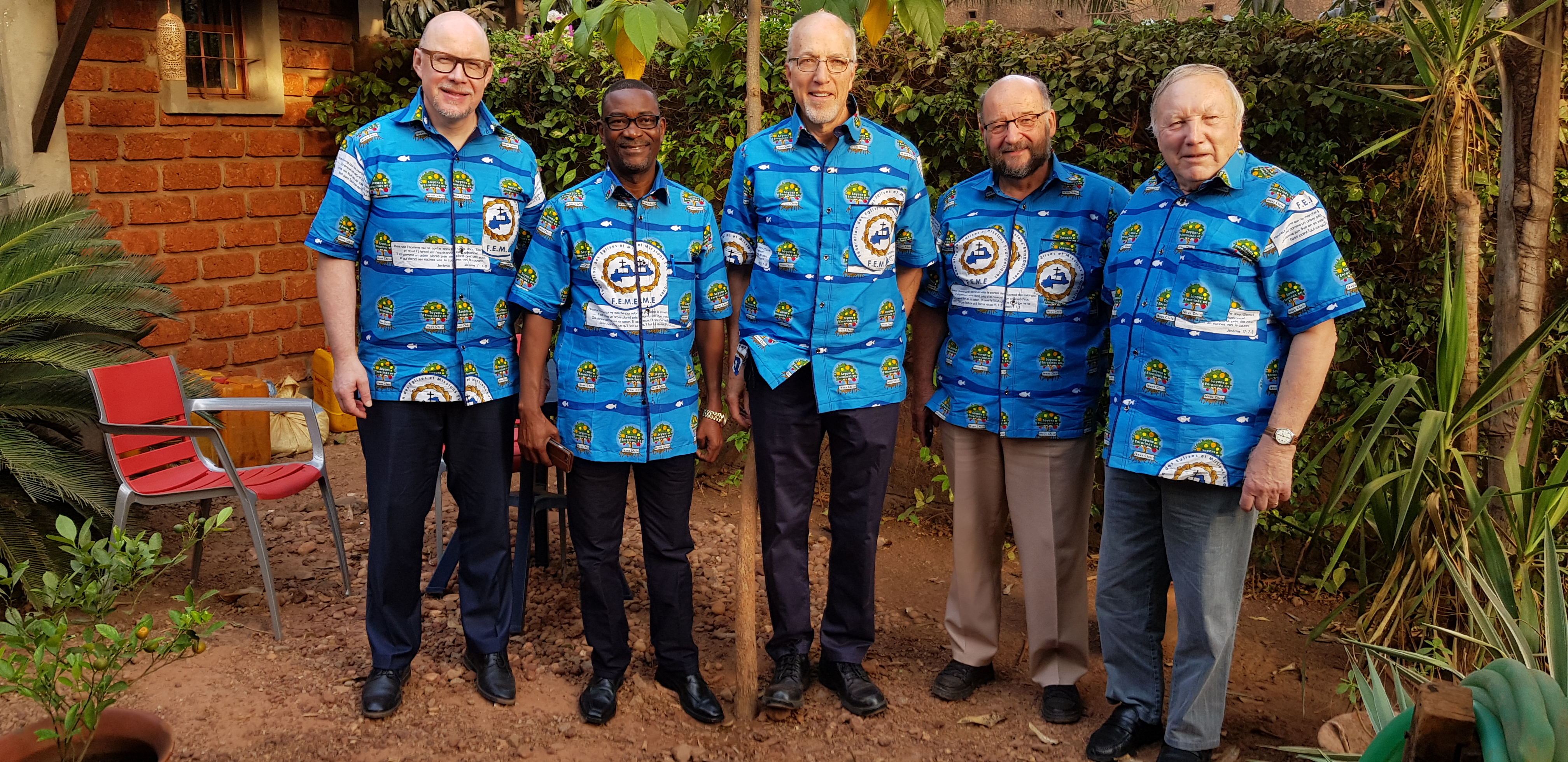 men in matching African cloth shirts
