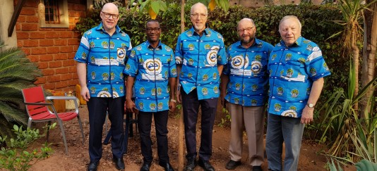 5 delegation members in matching shirts