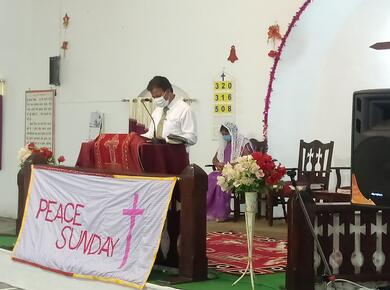 peace sunday banner behind pulpit