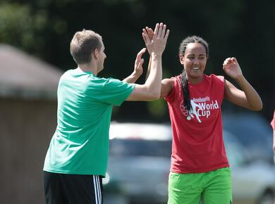 two soccer players high five