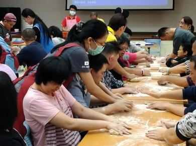 <p>New Dawn caregivers and clients make dumplings. Photo supplied by New Dawn</p>