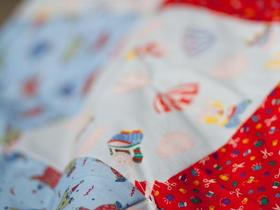 Hand-stitched quilts for relief. Photo: Rhoda Shirk