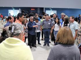 At Renewal 2027 in Costa Rica, Mennonites pray for migrants around the world. Photo: Henk Stenvers