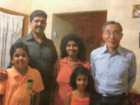 <p>Pastor Anura (left) and his family with Pastor Fuji (right). Photo supplied.</p>