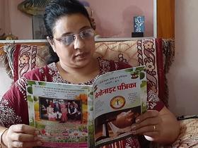 Shailja Sonwani, member of Sunderganj Mennonite Church Dhamtari, reads Mennonait Patrika, a quarterly magazine of Mennonite Church India Dhamtari CG. Photo supplied.