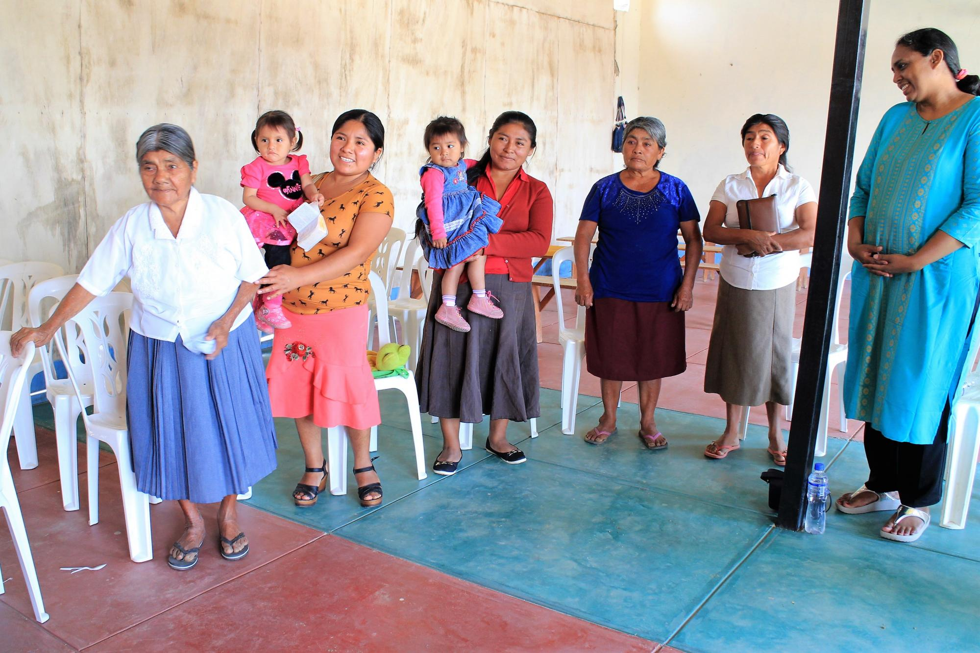 Faustina Valencia (blue shirt), a member of Iglesia Hermanos Menonitas Nuevo Paraíso (New Paradise Mennonite Brethren church) who was suffering with breast cancer, had her house washed away. Yet, the day the delegation met in her village with the local congregation, she offered food in her home. Photo: Henk Stenvers