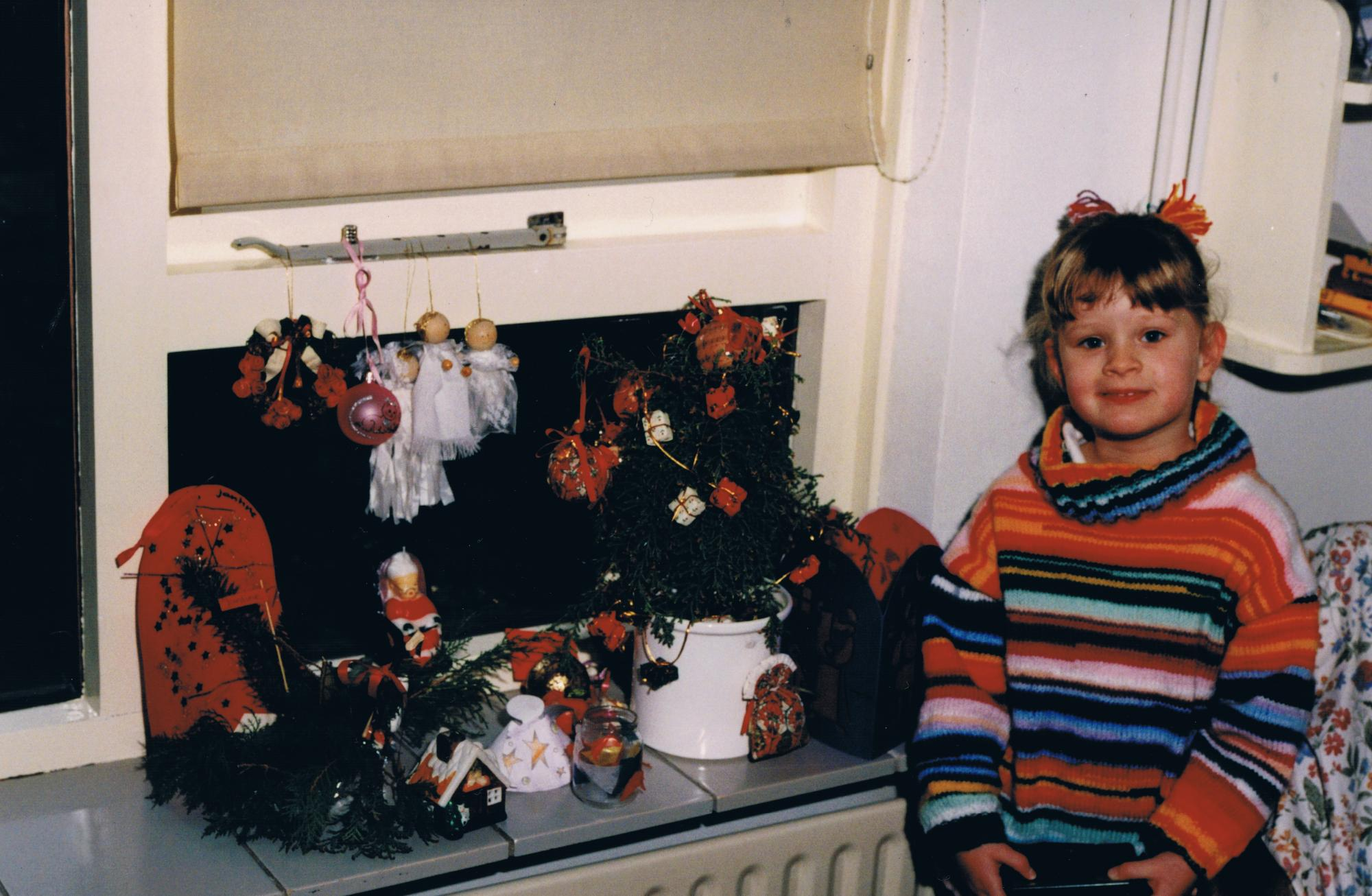 Jantine Huisman as a child with Christmas decorations. Photo courtesy of Jantine Husiman.