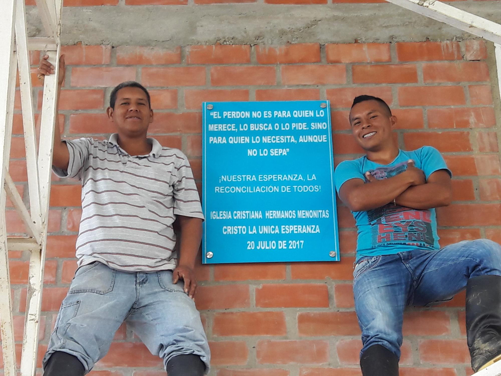 "Misael y Luis Yonda. Installation of the memory plaque in the sports arena in the village of La Esperanza. ""Forgiveness is not for the one who deserves it, seeks it or asks for it but for the one who needs it, although they are not conscious of it. Our hope is reconciliation for all! Christ the Only Hope Mennonite Brethren Church. 20 July 2017."" Photo: Sebastián Navarro Medina"