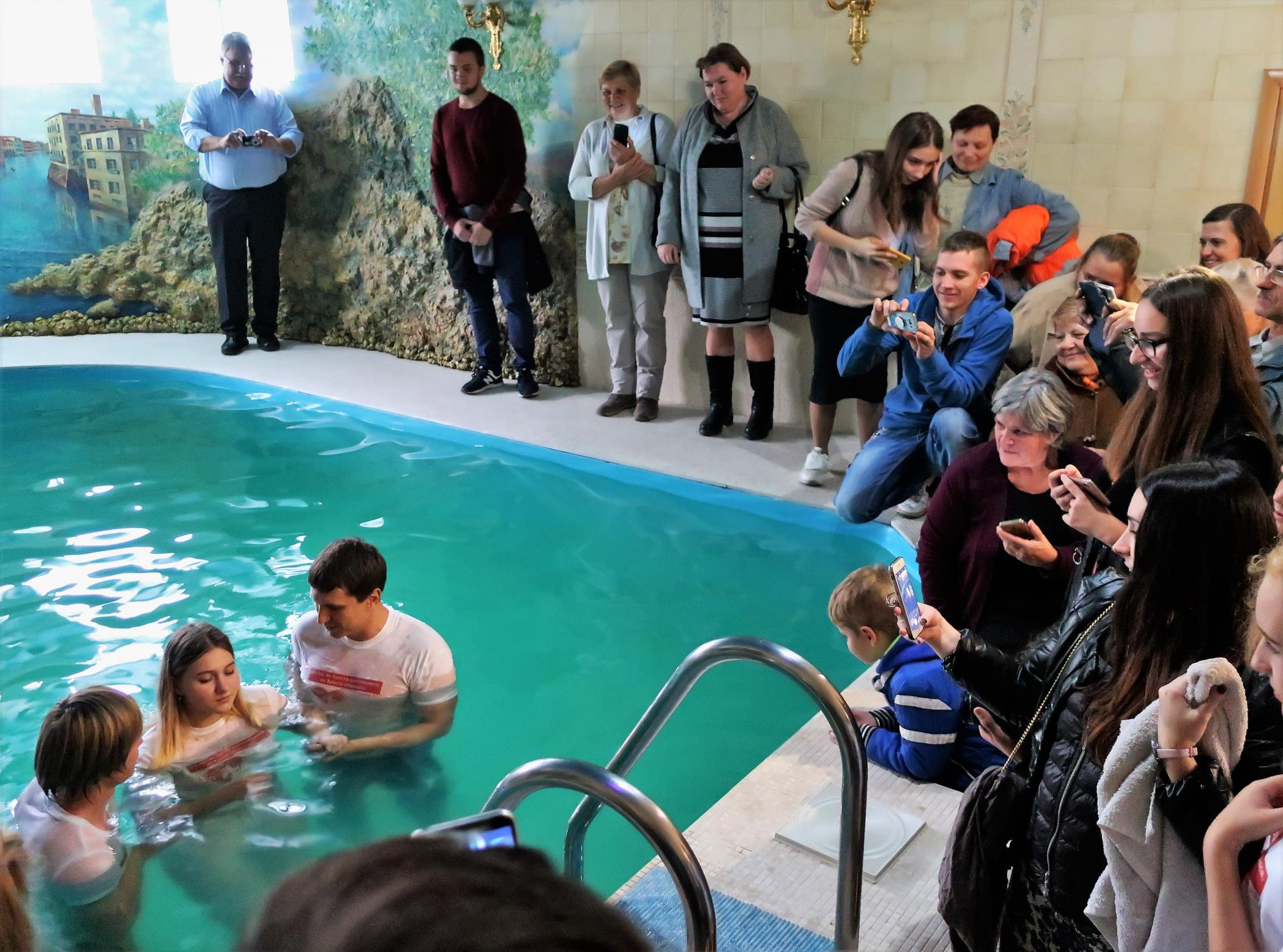 Seven women ages 16–22 were baptized at a nearby pool the day the European leaders visited. Photo: J. Nelson Kraybill