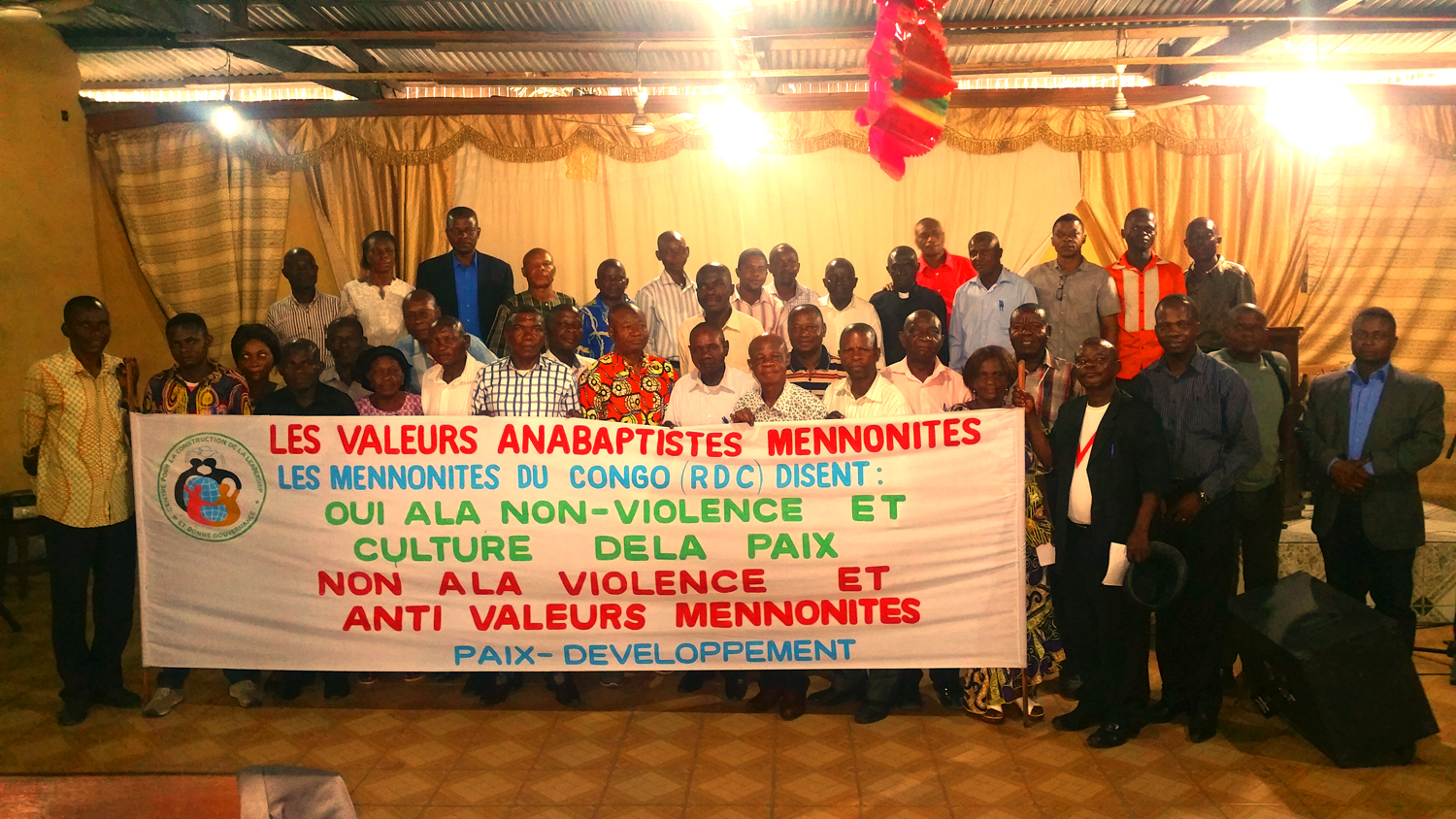 Participants discuss ideas and experiences during a workshop on Mennonite values and nonviolence in DR Congo.