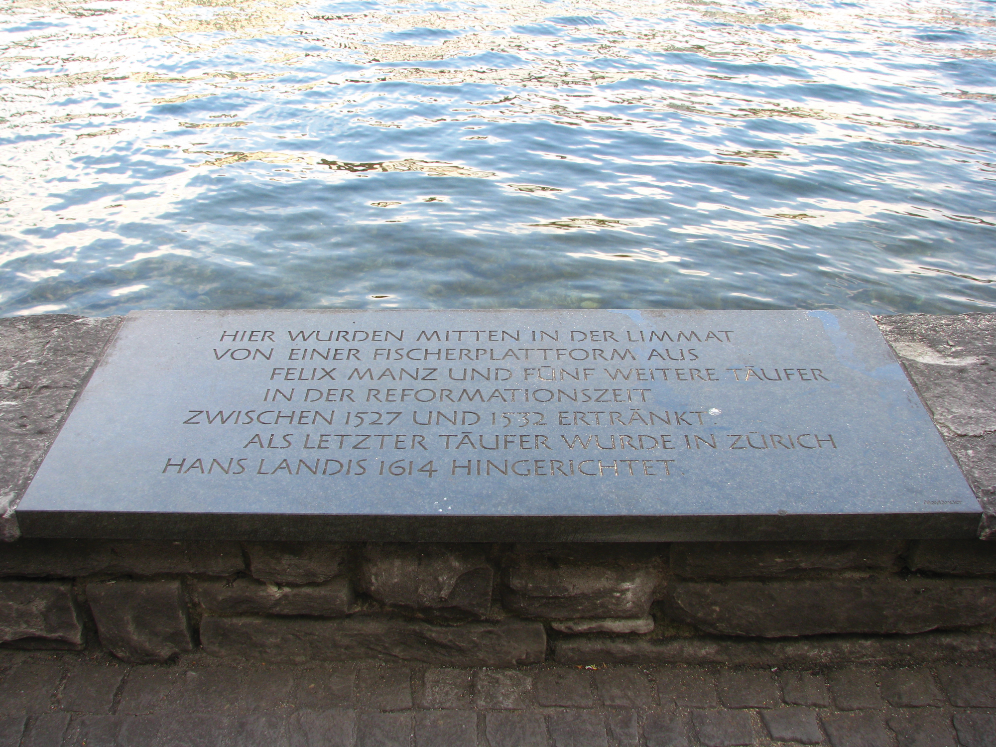 A memorial stone to Anabaptist martyrs drowned in the Limmat River in Switzerland. Photo: Roland zh, Wikimedia Commons