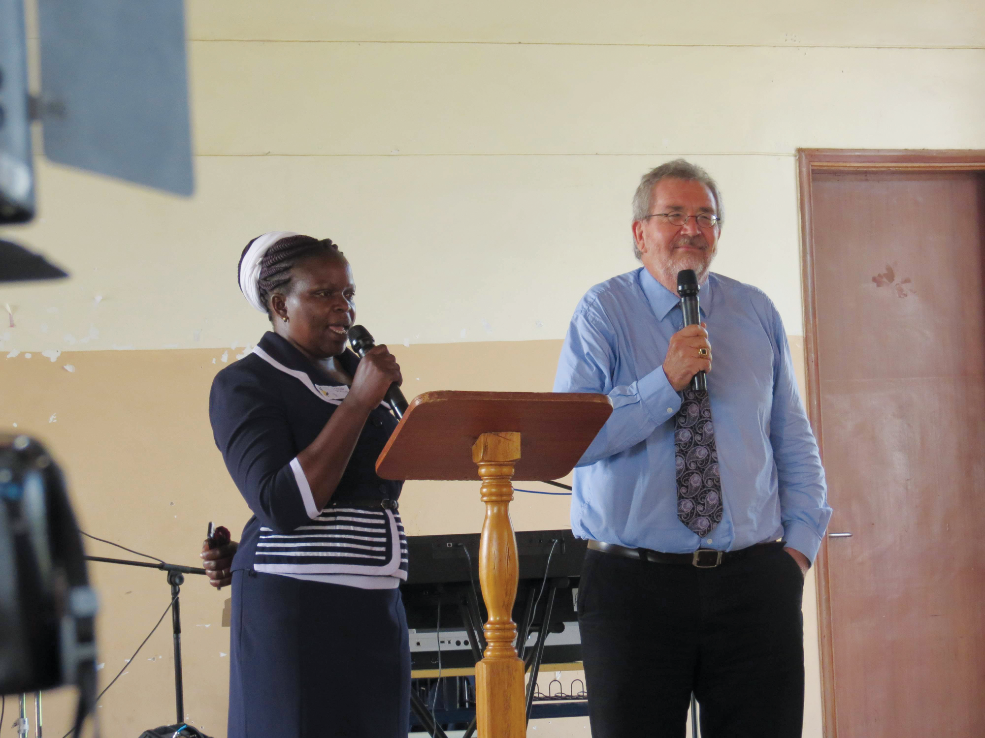 Preaching at Renewal 2027: Alfred Neufeld (r) with Swahili translator Caren Okello. Photo: Len Rempel