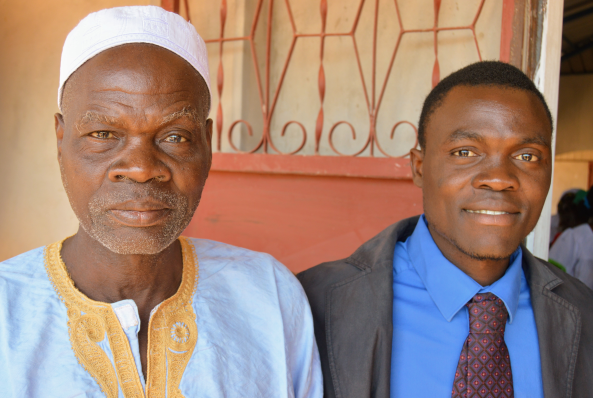 Daniel Djin-ale (right) is installed as a credentialed pastor on January 27 at the Catel Mennonite church in Guinea-Bissau. Dijn-ale's father (left), village chief and adherent of Islam, joins him for the event. Photo: Beryl Forrester