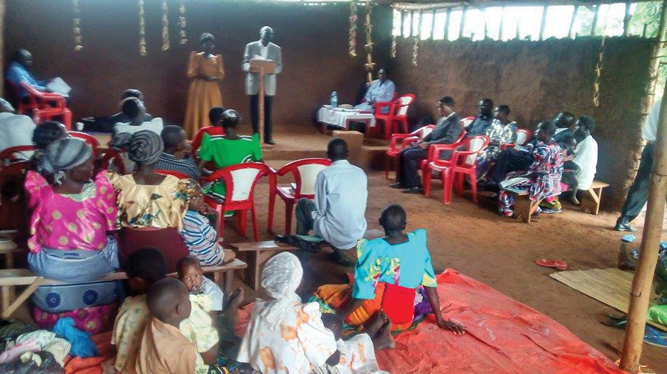 Some members sit on the floor at a Uganda Mennonite Church congregation which lacks the finances to purchase chairs. Photo: Okoth Simon Onyanga